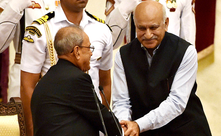 President Pranab Mukherjee shakes hands with M J Akbar after he was sworn-in as Minister of State at a ceremony at Rashtrapati Bhavan in New Delhi on Tuesday. PTI Photo by Shahbaz Khan