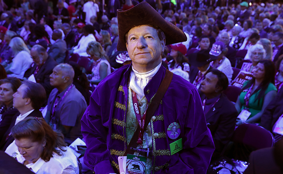 A California delegate in Revolutionary War garb stands amidst other delegates during the third session. (REUTERS/Aaron P. Bernstein)