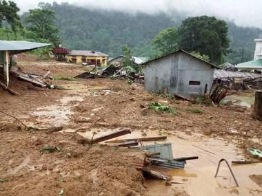 Damaged houses after heavy torrential rains at Bhalukpong, Arunachal Pradesh. PTI