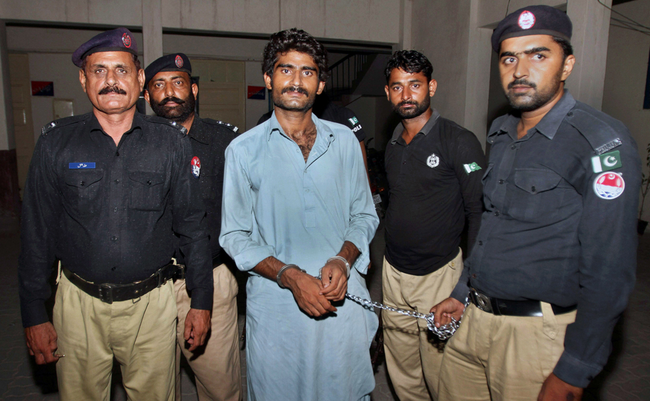 "Pakistani police officers present Waseem Azeem, the brother of slain model Qandeel Baloch, before the media following his arrest at a police station in Multan, Pakistan, Sunday, July 17, 2016. Pakistani police say the brother of slain model Baloch has confessed to strangling her to death for ""family honor"" because she posted ""shameful"" pictures on Facebook. (AP Photo/Asim Tanveer)"