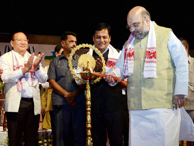 Bharatiya Janata Party (BJP) president Amit Shah lighting the inaugural lamp at North East Democratic Alliance (NEDA) conclave at Srimanta Sankardev Kalakshetra in Guwahati on Wednesday. PTI