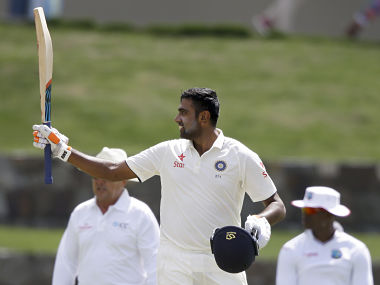 India's Ravichandran Ashwin raises his bat after scoring a century. AP