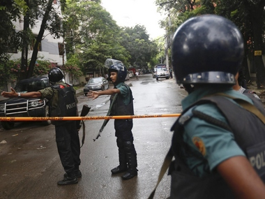 Bangladeshi policemen clear out an area to facilitate action against heavily armed militants who struck at the heart of Bangladesh. AP