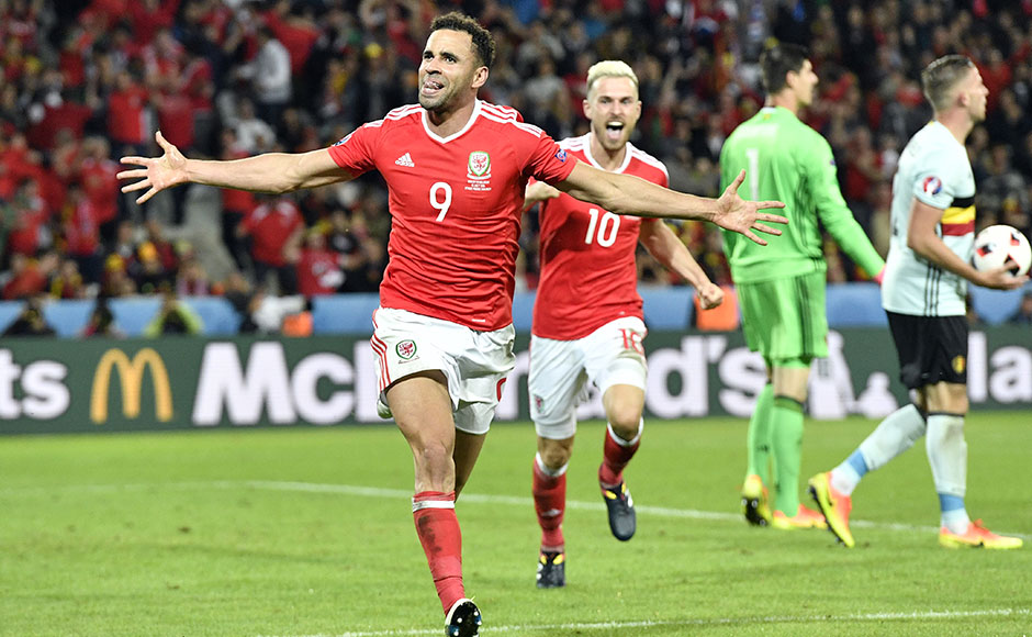 Wales' Hal Robson Kanu, left, celebrates after scoring his side's second goal during the Euro 2016 quarterfinal soccer match between Wales and Belgium, at the Pierre Mauroy stadium in Villeneuve d'Ascq, near Lille, France, Friday, July 1, 2016. (AP Photo/Martin Meissner)