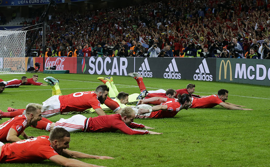 Welsh players celebrate their 3-1 win at the end of the Euro 2016 quarterfinal soccer match between Wales and Belgium, at the Pierre Mauroy stadium in Villeneuve d'Ascq, near Lille, France, Friday, July 1, 2016. (AP Photo/Petr David Josek)