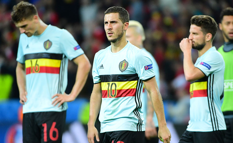 Belgium's forward Eden Hazard (C) reacts after the Euro 2016 quarter-final football match between Wales and Belgium at the Pierre-Mauroy stadium in Villeneuve-d'Ascq near Lille, on July 1, 2016. Wales won the match 3-1. / AFP PHOTO / EMMANUEL DUNAND