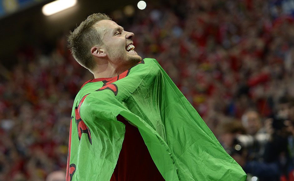 Wales' defender Chris Gunter celebrates at the end of the Euro 2016 quarter-final football match between Wales and Belgium at the Pierre-Mauroy stadium in Villeneuve-d'Ascq near Lille, on July 1, 2016. / AFP PHOTO / MIGUEL MEDINA