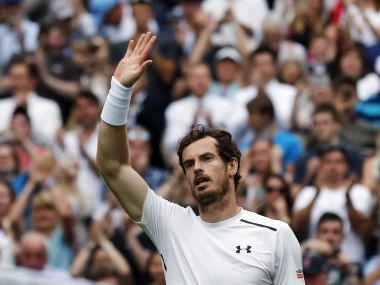 Andy Murray waves to the crowd. AP