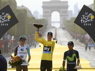 Britain's Chris Froome, wearing the overall leader's yellow jersey, second place Romain Bardet of France and third place Nairo Quintana of Colombia celebrate on the podium. AP