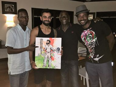 Virat Kohli posing with Viv Richards, Richards and his artist friend. Image courtesy: BCCI twitter.