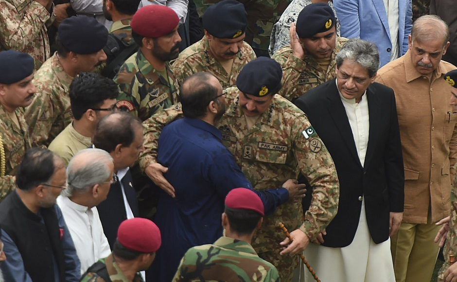 Pakistan Military Chief Raheel Sharif hugs the son of Abdul Sattar Edhi, Faisal Edhi (C), during his father's funeral in Karachi on July 9, 2016. A top commander from the largest rebel group in Indian-administered Kashmir was killed in a gun battle with government forces on July 8, police said. Young and media savvy, Burhan Wani was a top figure in Hizbul Mujahideen and had a one million rupee ($14,900) bounty on his head. Wani, 22, joined the rebel movement at the age of 15 and in recent years had been behind a huge recruitment drive to the group's ranks, attracting young and educated Kashmiris to the decades-old fight for independence of the restive disputed region. Viewed locally as a hero, his death sparked protests in nearby Anantnag town, with hundreds taking to the streets shouting independence slogans and lauding Wani as a revolutionary, witnesses said. / AFP PHOTO / ASIF HASSAN