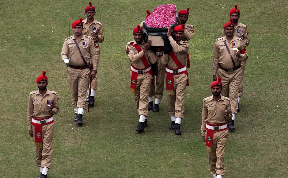 Pakistani soldiers carry the coffin containing the body of Pakistan's renowned social worker Abdul Sattar Edhi for a funeral in Karachi, Pakistan, Saturday, July 9, 2016. Tens of thousands of people attended Saturday the state funeral for Pakistan's legendary philanthropist, Abdul Sattar Edhi, in Karachi, officials said. (AP Photo/Shakil Adil)