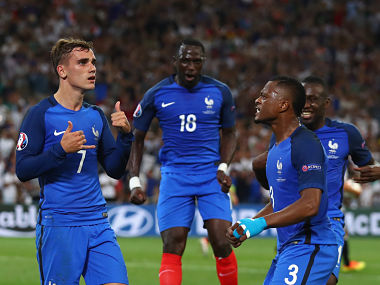 Antoine Griezmann (L) celebrates after scoring the opening goal from the penalty spot. Getty
