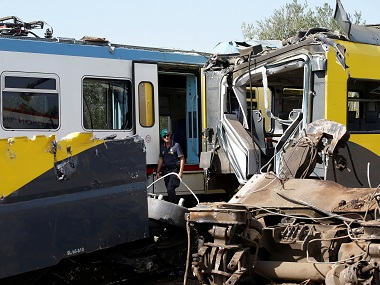 A police officer walks near the wreckage at the site of the train crash. Reuters