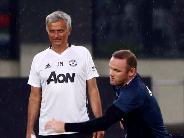 Jose Mourinho during training with Manchester United captain Wayne Rooney. Reuters