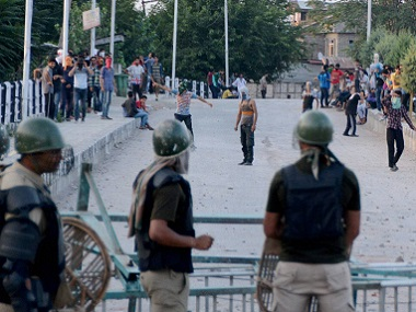 Kashmiri youth defied curfew in Srinagar on Sunday. PTI