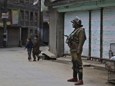 Kashmir unrest Curfew imposed mobile connection off as normal life is disrupted