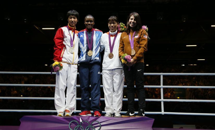 MC Mary Kom poses for official photographs with her bronze medal in boxing at the London Olympics in 2012. Getty Images