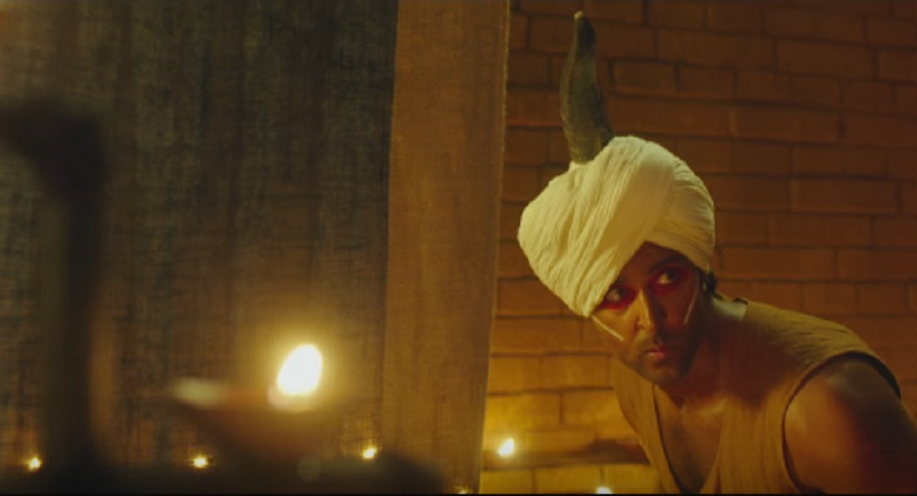 Sarman makes his way into the ritual hall. Don't miss the horn on his head. Screengrab from YouTube