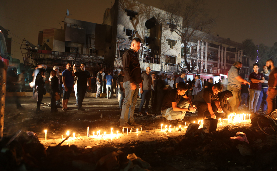 People light candles at the scene of the attack. Karrada was busy at the time as Iraqis eat out and shop late during the Muslim fasting month of Ramzan, which ends next week with the Eid al-Fitr festival. Photo Courtesy: AP