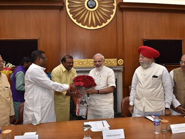 PM Narendra Modi with his new Council of Ministers on Tuesday at the PMO. PIB