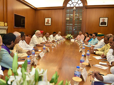Prime Minister Narendra Modi with his new Cabinet ministers. PIB
