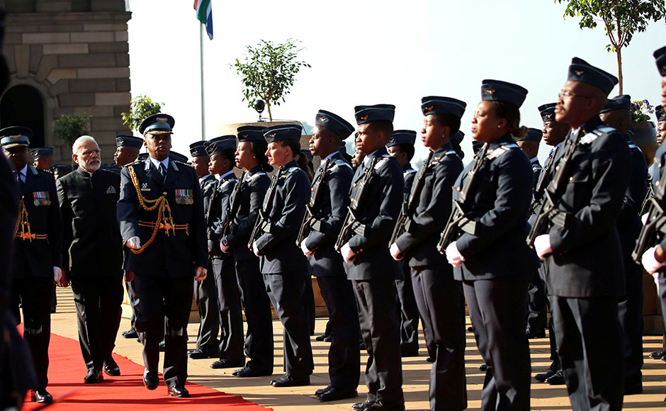 India's Prime Minister Narendra Modi (2nd L) inspects a guard of honour during his state visit at the Union Buildings in Pretoria, South Africa July 8, 2016. REUTERS