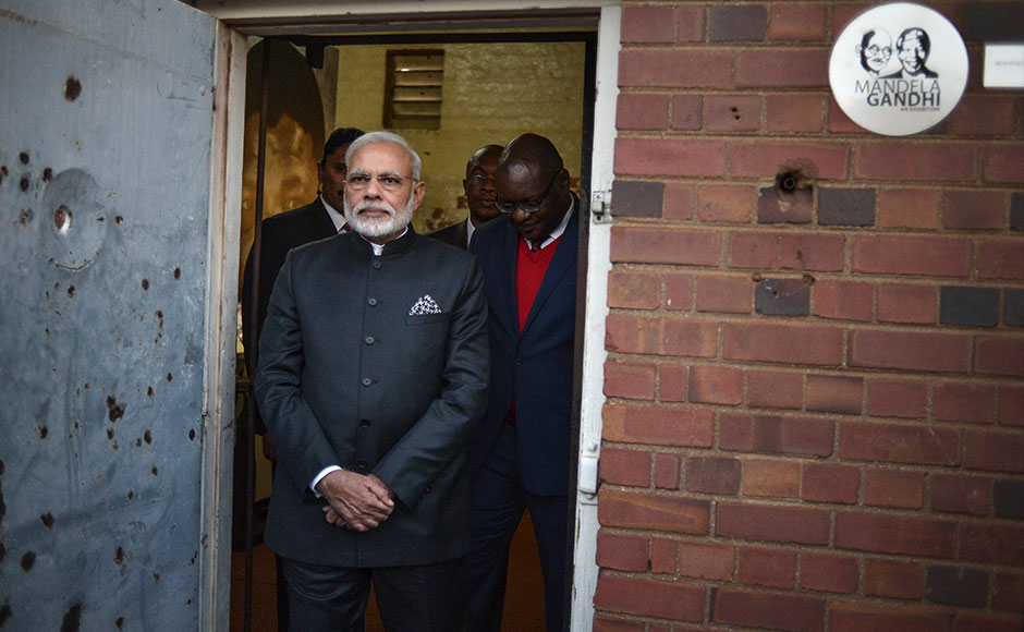 "Indian Prime Minister Narendra Modi visits the Constitutional Hill in Johannesburg on July 8, 2016, where Indian independence hero Mahatma Gandhi and South African former president and liberation icon Nelson Mandela were kept in prison. Indian Prime Minister Narendra Modi took his Africa tour to South Africa on Friday, seeking to boost trade between two countries that he said ""shared values, suffering and struggles"". Among the countries' cultural and historic links is the 21 years that Mahatma Gandhi spent living in South Africa as a young lawyer and activist. / AFP"