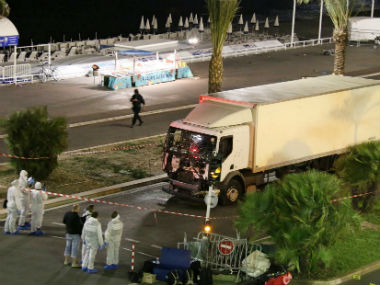 Police investigate the truck involved in the Nice attack. AP