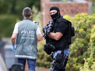 French police are seen at the scene during a raid after a hostage-taking in the church in Saint-Etienne-du-Rouvray. Reuters