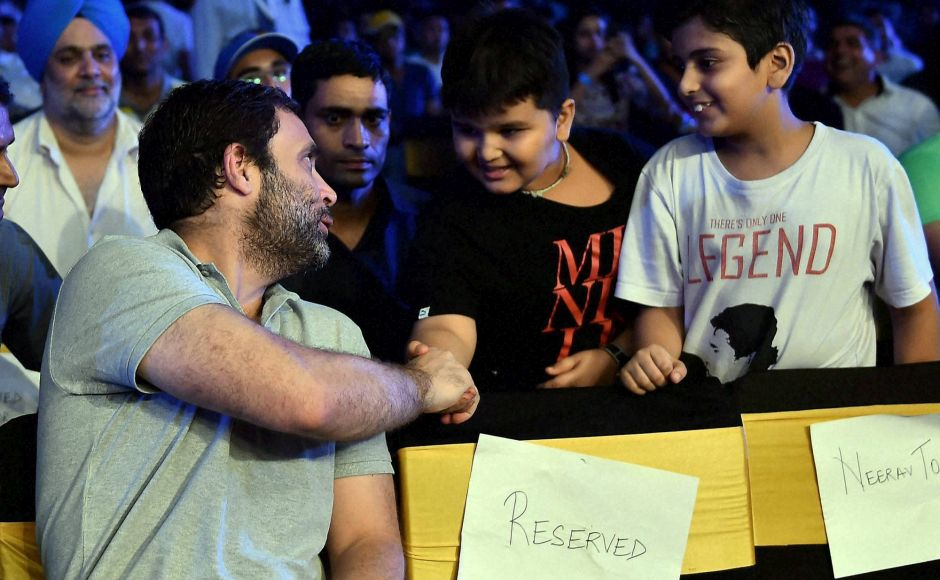 New Delhi: Congress Vice Pesident Rahul Gandhi greets his young fans at the WBO Asia Pacific Middleweight Championship at Thyagaraj Sports Complex in New Delhi on Saturday.PTI Photo by Manvender Vashist(PTI7_16_2016_000207B)