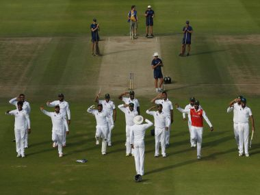 Pakistan's players celebrate winning the first test with a salute. Reuters