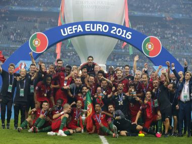 Portugal's team celebrates with the trophy after winning the Euro 2016. AP
