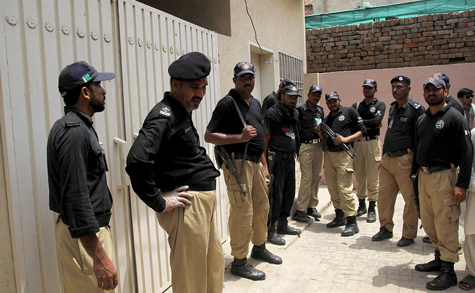 Pakistani policemen stand guard outside the house of social media celebrity, Qandeel Baloch who was murdered by her brother, in Multan on July 16, 2016. A Pakistani social media celebrity whose selfies polarised the deeply conservative Muslim country has been murdered by her brother in a suspected honour killing, officials said on July 16, prompting shock and revulsion. Qandeel Baloch, held up by many of the country's youth for her willingness to break social taboos but condemned and reviled by traditional elements, was strangled near the city of Multan, police said. SS MIRZA / AFP