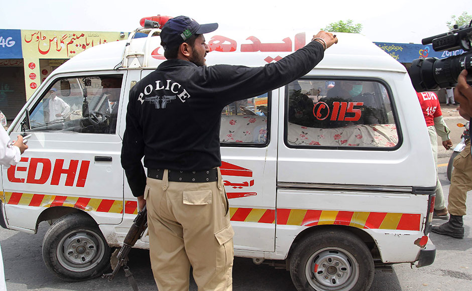 A Pakistani policeman stands alongside an ambulance carrying the body of social media celebrity, Qandeel Baloch in Multan on July 16, 2016. A Pakistani social media celebrity whose selfies polarised the deeply conservative Muslim country has been murdered by her brother in a suspected honour killing, officials said on July 16, prompting shock and revulsion. Qandeel Baloch, held up by many of the country's youth for her willingness to break social taboos but condemned and reviled by traditional elements, was strangled near the city of Multan, police said. SS MIRZA / AFP