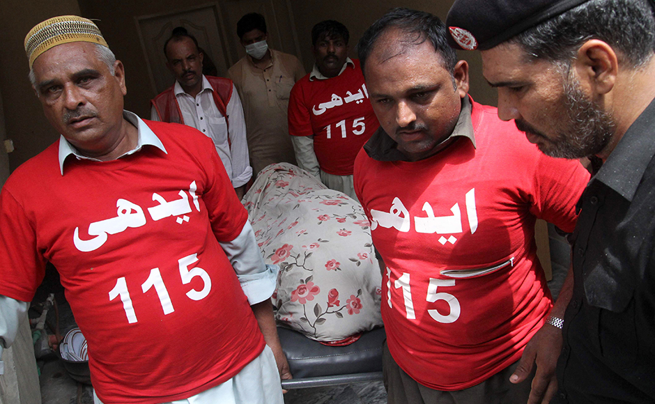 Pakistani volunteers move the body of social media celebrity, Qandeel Baloch from her residence in Lahore on July 16, 2016. A Pakistani social media celebrity whose selfies polarised the deeply conservative Muslim country has been murdered by her brother in a suspected honour killing, officials said on July 16, prompting shock and revulsion. Qandeel Baloch, held up by many of the country's youth for her willingness to break social taboos but condemned and reviled by traditional elements, was strangled near the city of Multan, police said. SS MIRZA / AFP