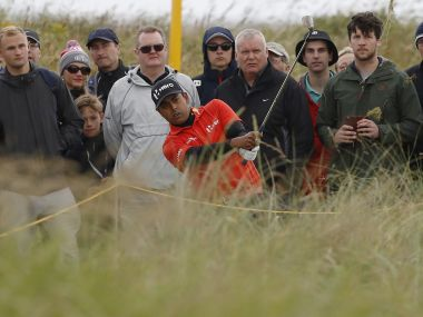 Anirban Lahiri plays from the rough on the second hole during the third round. Reuters