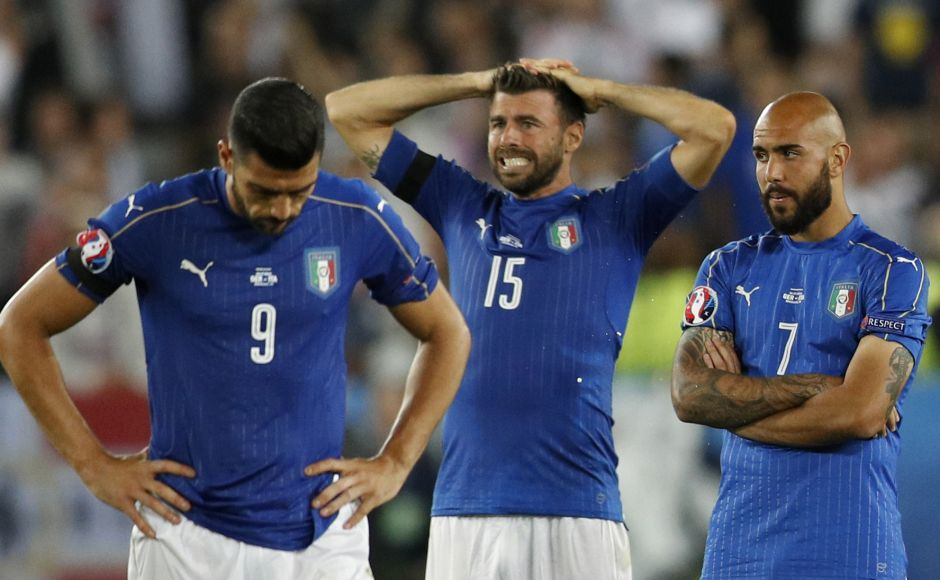 Football Soccer - Germany v Italy - EURO 2016 - Quarter Final - Stade de Bordeaux, Bordeaux, France - 2/7/16 Italy's Graziano Pelle, Andrea Barzagli and Simone Zaza react after the penalty shootout REUTERS/Darren Staples Livepic - RTX2JFPL