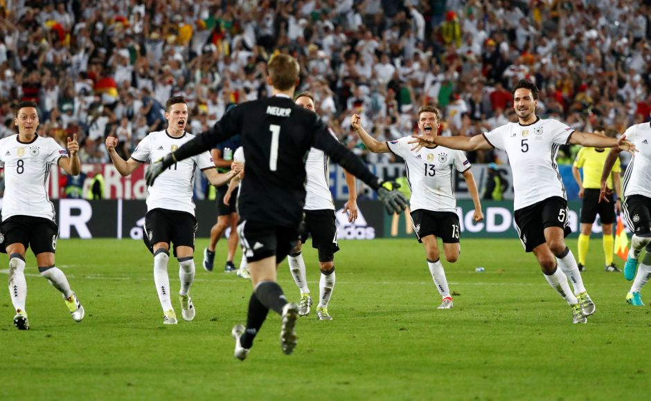 Football Soccer - Germany v Italy - EURO 2016 - Quarter Final - Stade de Bordeaux, Bordeaux, France - 2/7/16Germany players celebrate winning the penalty shootoutREUTERS/Christian HartmannLivepic TPX IMAGES OF THE DAY - RTX2JFR7