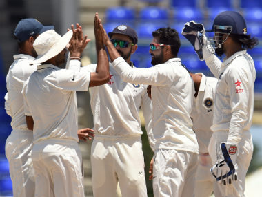 Ravindra Jadeja (2nd from right) celebrates the fall of a wicket during the opening day of the second practice match. AFP