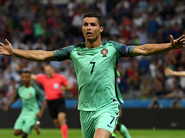 Cristiano Ronaldo of Portugal celebrates scoring the opening goal against Wales. Getty
