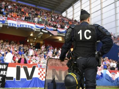 Riot police stand in front of fans section during the Euro 2016 round of 16 match. AP
