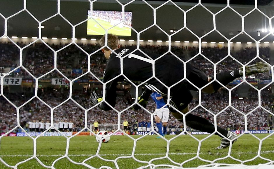 Germany goalkeeper Manuel Neuer saves a penalty by Italy's Leonardo Bonucci during the Euro 2016 quarterfinal soccer match between Germany and Italy, at the Nouveau Stade in Bordeaux, France, Saturday, July 2, 2016. Germany beat Italy 6-5 in a penalty shootout. (AP Photo/Antonio Calanni)