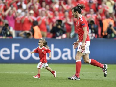 Gareth Bale celebrates with his daughter Alba after winning the Euro 2016 round of 16 match. AP