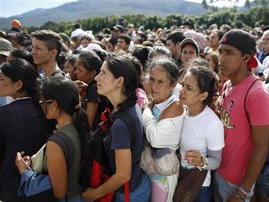 It's the second weekend in a row that Venezuela's government has opened the long-closed border connecting Venezuela to Colombia. AP.