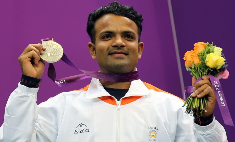 Olympic Gold Quest athelete Vijay Kumar stands with his silver medal. Reuters