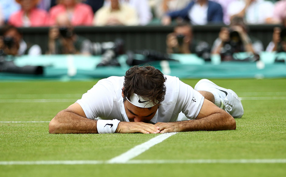 Roger Federer of Switzerland reacts after he slips during the Men's Singles Semi Final match against Milos Raonic of Canada on day eleven of the Wimbledon Lawn Tennis Championships at the All England Lawn Tennis and Croquet Club on July 8, 2016 in London, England.