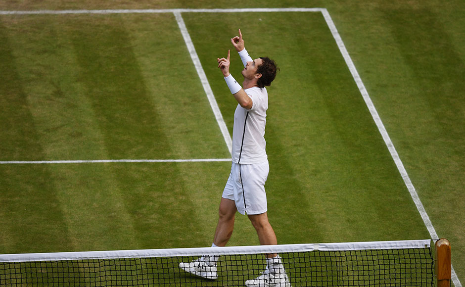 Andy Murray of Great Britain celebrates victory during the Men's Singles Semi Final match against Tomas Berdych of The Czech Republic on day eleven of the Wimbledon Lawn Tennis Championships at the All England Lawn Tennis and Croquet Club on July 8, 2016 in London, England. Getty