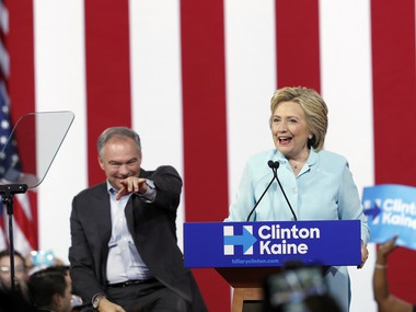 Democratic presidential candidate Hillary Clinton is joined by Sen. Tim Kaine, D-Va., as she speaks at a rally at Florida International University Panther Arena in Miami, Saturday, July 23, 2016. Clinton has chosen Kaine to be her running mate. (AP Photo/Mary Altaffer)