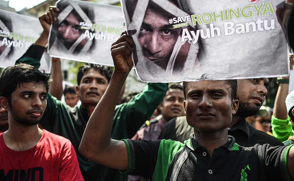 "Myanmar ethnic Rohingya Muslim people living in Malaysia display placards during a protest against the persecution of Rohingya Muslims in Myanmar, outside the Myanmar embassy in Kuala Lumpur on July 15, 2016. The European Parliament on July 8 urged Myanmar to end what it termed ""brutal repression"" and ""systematic persecution"" against the country's Rohingya Muslim minority. / AFP PHOTO / MOHD RASFAN"
